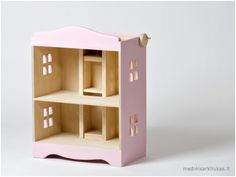 Wooden doll house with a lift