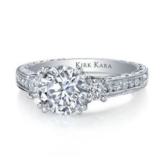 Kirk Kara Stella Hand-Engraved Three Stone Engagement Ring Crafted with 0.51 Carats of Diamonds Set in 18kt White Gold.