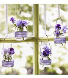 Baby food jars are the perfect size to display small flowers, like pansies, and this tutorial shows how easy it is to convert the jars into minivases. Source: Good Housekeeping
