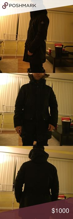 Stone Island's Winter Jacket It's a Black winter jacket from Stone Island. It has rabbit furs on hood and inside it had a removable down padding in olive color, which makes this coat extremely warm. You can remove the padding and wear it as a safari coat during warmer seasons as well. Very high utility and fashionable coat. Its made with parachute materials. If you want to differentiate yourself with those who wear moncler and canda goose, this is the one. Stone Island Jackets & Coats…
