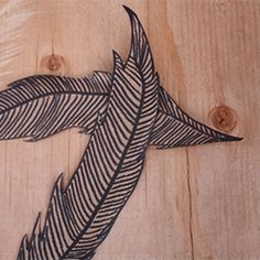 Here is a simple DIY you can do to add a fun element of design to your home decor: paper feathers!