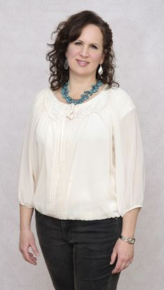 Michelle looks comfortable and lovely in her Type 2 outfit. She's wearing the Courtly Cream top with the Meant To Be Necklace in blue and the Imagine Bliss Earring from the Dressing Your Truth Store! Get her look at https://dyt.liveyourtruth.com/store/type2 #DYT #Type2