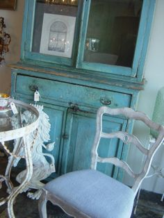 "My friend Lori's shop ""BLEU"" in Fair Oaks, CA.  Gorgeous original cupboard. Chair redesigned by me."
