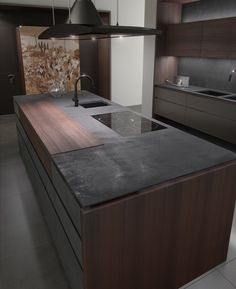 A darker look. Toncelli at Fuorisalone 2013: island looks very functional and elegant, floating counter, wood elements