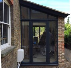 straight on picture of the gable glazing and door with sidelightse