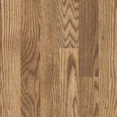 Pergo Max 7-in W x 3.96-ft L Tidewater Oak Embossed Laminate Wood Planks  Flooring for most of the house. It is absolutely beautiful when down!