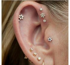 Tragus piercing, and forward (?) helix piercings