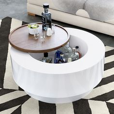 Ya Ya white lacquer round storage coffee table with walnut wood veneer drinks tray lid by Lenny Kravitz Design for CB2