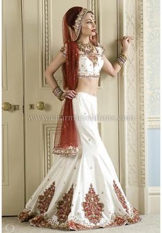 White and red lehenga. Love the design and shape of the lehenga, looks modern yet it's still looks great for a traditional Indian wedding.