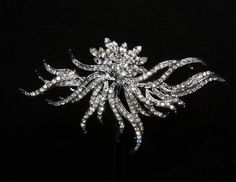 "picture it upside down... i think it kind of looks like a firework!    3.8"" x 2.5""  Art Deco vintage rhinestone crystal wedding bridal craft brooch sparkle supply. $14.99, via Etsy."