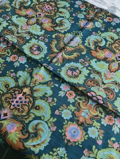 A personal favourite from my Etsy shop https://www.etsy.com/se-en/listing/609797777/60s-vintage-fabric-floral-print-english