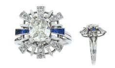 Diamond, sapphire and 18 karat white gold Art Deco ring with 1 cushion cut diamond weighing1.58 carats, 6 french cut sapphires weighing 0.20 carats and 18 round diamonds weighing 0.55 carats. Circa 1930's.