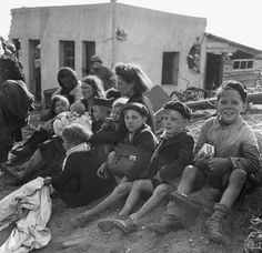 French civilian refugees who sought refuge in a beachhead area in Normandy on june 10, 1944. (AP Photo)