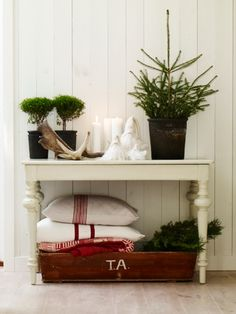 Love the antlers, the simplicity, and the fabric of the pillows!