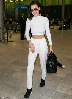 Bella Hadid shows off her flat stomach in a white crop top and matching trousers as she lands in Paris | Daily Mail Online