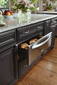 Dinner is served. Decora Cabinetry's warming drawer ensures dinner is hot and ready when guest arrive.