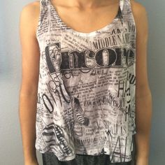 Black and white shirt black and white newspaper themed shirt. It is a size large but fits a small. Forever 21 Tops Tank Tops
