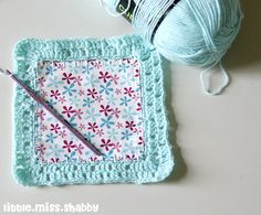 Fabric and crochet blanket. Pattern from Sewing Daisies is here http://www.sewingdaisies.com.au/sewing_daisies/2011/03/kaffe-fusion-completed.html