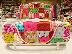 this might be taking patchwork to a whole new strange level. The footboard furniture frame is so pretty the patchwork takes away from it's beauty, on the other hand the headboard is really interesting. I hope they have a really dark room to sleep in or this could keep you awake.