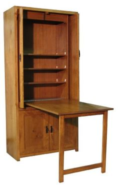 Repurposed armoire/ sewing cabinet. Fold table top & legs into ...