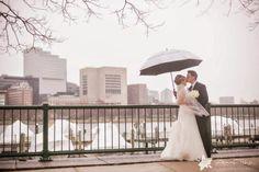 Royal Sonesta Boston Wedding - photo by Zev Fisher Photography http://zevfisherphoto.com/  #weddings #Boston #skyline #waterfront #weddingphotos #umbrella #rainy