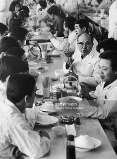 Japanese industrialist and founder of Honda corporation Soichiro Honda (1906 - 1991) (at right, in eyeglasses) eats lunch with employees in a Honda manufacturing plant, Tokyo, Japan, 1967.