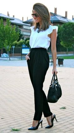 chic work outfit white sleeveless + black pants combination