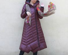 This women winter jacket fill with down.we design it with a very thick and warm style.this hooded down coat could keep you very warm in the cold winter.the side pockets also is very useful.the side unique design is very attractive . for other down coat: www.etsy.com/shop/liferollpaint?ref=hdr_shop_menu§ion_id=16669634 Linen women clothing: https://www.etsy.com/shop/liferollpaint?ref=hdr_shop_menu§ion_id=16669634 women strechy pants www.etsy.c...