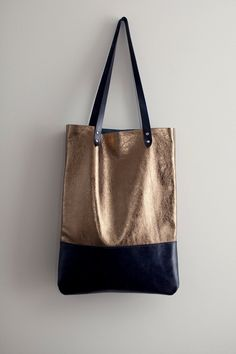Brass Metallic with Navy Blue Leather Tote bag No. TL- 3001. $98.00, via Etsy.