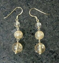Citrine Drop Earrings (Gold)  Was £13.45 - Now £12.11!  These handmade earrings are made from genuine semi-precious Citrine gemstones on 9ct gold plated 925 sterling silver earwires. They have a drop of 4cm (1.6'').