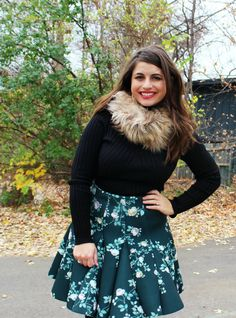 Faux fur dressed up a black turtleneck & evergreen florals for the holidays.