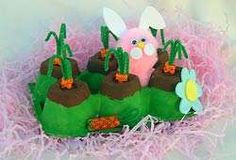 easter upside down egg carton painted and decorated with pipe cleaner and pom poms and foam paper for the bunny.