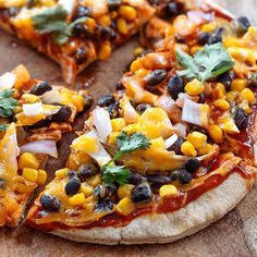 This BBQ Chicken Flatbread Pizza is smothered with beans, onions, barbecue sauce, and cheese. It tastes just like summer. Get the recipe.