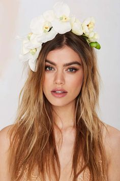 Festival hair: faux orchid flower crown laid against long, messy waves