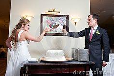 Funny bride and groom near wedding cake by Ryzhov Sergey, via Dreamstime