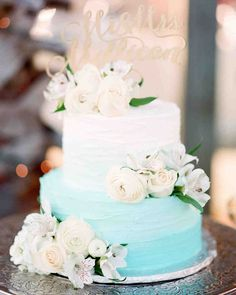 The Prettiest Ombré Wedding Cakes for Couples Who Love Color | Martha Stewart Weddings - This tinted beauty's cream-to-turquoise frosting was a nod to the couple's watercolor theme. #ombre #weddinginspiration #weddingcake #cakeinspiration