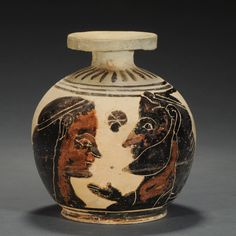 CORINTHIAN POTTERY ARYBALLOS    With the head of a man and a woman vis-à-vis; stylized rosettes in the field.     Ca. 570-560 BC