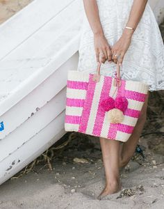- Description - Artisan Carry this bag with you and everyday will feel like a beach day. This seaside inspired tote is spacious enough for all your belongings. This beautiful striped bag is composed o
