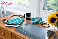 You can be tech savvy and organized! Thirty-One's Tote-A-Tablet and Every-Day Wristlet are perfect for keeping all your electronics safe and stylish!