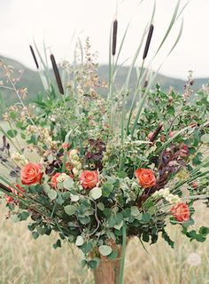 Autumn floral centerpiece with cattails | Bryce Covey Photography and Bluebird Productions | see more on: http://burnettsboards.com/2014/09/indian-summer-heat-wave-wedding/