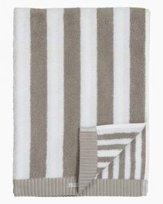 Made of thick cotton terrycloth, this hand towel features stripes in different widths on each side. Pattern: Kaksi raitaa Pattern Designer: Kristina Isola Material: 100 % Cotton Size: 50 x 100 cm ( x ) Color: grey, white