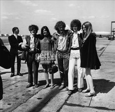 The Cream    ref:3297119_10    20th August 1967: The three piece British rock group Cream. From left to right - Jack Bruce, Ginger Baker and Eric Clapton, with girlfriends, at London Airport. (Photo by George Stroud/Express/Getty Images)
