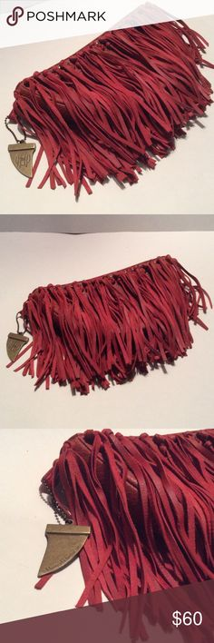 House of Harlow 1960 Fringe Clutch Purse Bag NWOT Darkish dusty coral or reddish orange, terra cotta...11 inches long, 6 inches tall and about 3 inches across the thickness at top- black satin lined with interior pockets. Purchased new, Never used, just stored. Signature ornament as shown. Studs and tassel fringe both sides. Easily fits cell phone, random personal items. House of Harlow 1960 Bags Clutches & Wristlets