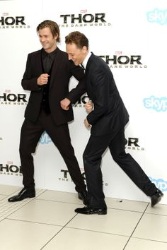Chris Hemsworth and Tom Hiddleston attend the World Premiere of 'Thor: The Dark World' at The Odeon Leicester Square on October 22, 2013 in London, England [HQ]