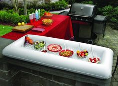 This Inflatable Buffet Cooler is the perfect solution for parties and serving crowds. Inflate it when you need it, fill with ice and keeps multiple bowls, dishes and drinks cold. When the party is over, simply drain, deflate and fold flat for storage. No more bulky coolers that take up too much space. Extra-large, rectangular serving station measures 51 in. L x 25 in. W x 4.5 in. D