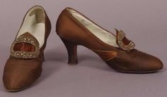 """Dark brown satin pumps with steel bead buckles, American, 1920-25. Worn by Mrs. Harry Norton Torrey, the granddaughter of Captain John B. Ford, who was the founder of the first plate glass company in America. Label: """"B. Siegel and Co., Detroit"""""""
