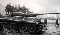 T-34/85 with grid-frame protections to defend against panzerfausts, Brandenburg Gate, Berlin, Germany. May 1945