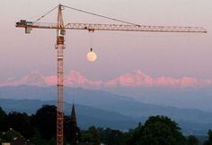 Moon Hanging from a Crane
