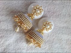 How to make designer silk thread jhumka at home I DIY Pearl based jhumka earring. In this video, we have shown the making of wedding and party wear jhumkas in an easy way based on pearls. This video shows how to make designer silk thread jhumkas at home. Silk Thread Earrings Designs, Silk Thread Jhumkas, Silk Thread Bangles Design, Thread Bracelets, Handmade Bracelets, Earrings Handmade, Beaded Bracelets, Silver Jewellery Indian, Jewellery Diy