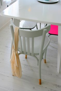 white painted chair, love the little colour on the legs...